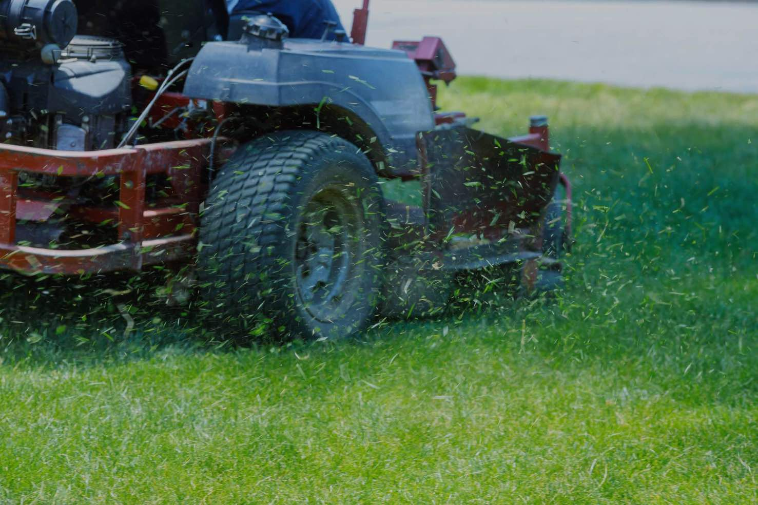 person mowing a lawn